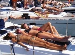 Sunbathing on board.